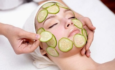 cucumbers being applied on face as razor bump relief