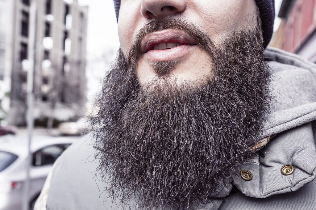 Photo of a man's beard with beard wax