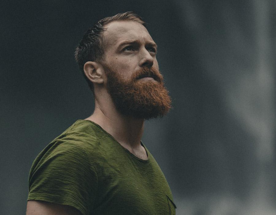 bearded man lookin up