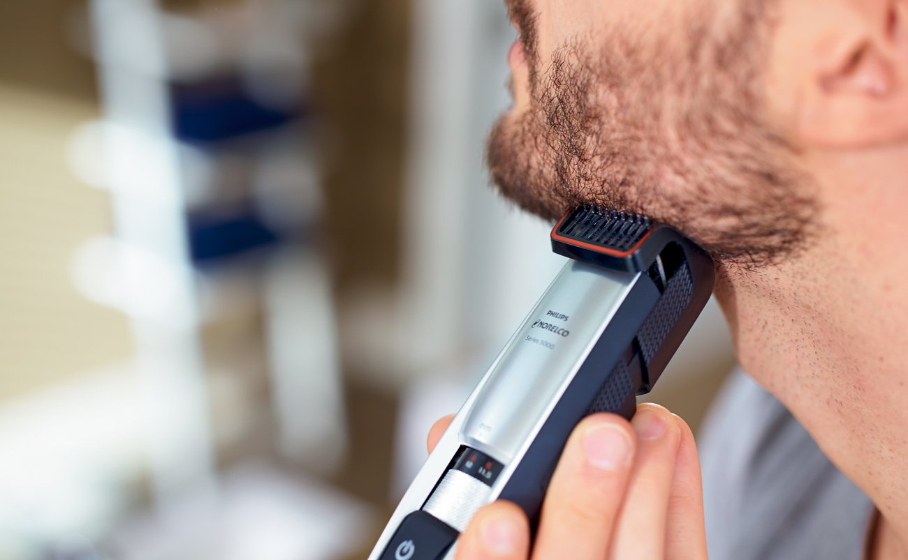 Man using one of the best beard trimmer models today, the Philips Norelco Series 5100