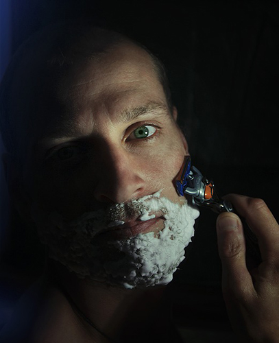 man shaving with shaving foam