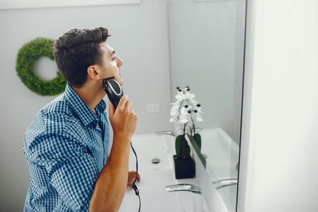 man shaving moustache